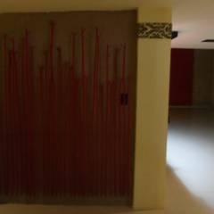 DECORACION EN MUROS: Paredes de estilo  por Bello diseño interior