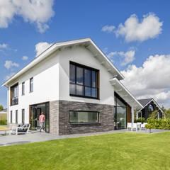 Modern woonhuis aan het water:  Eengezinswoning door BNLA architecten