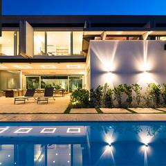 FMG Monte Alegre: Casas  por Urbem Arquitetura