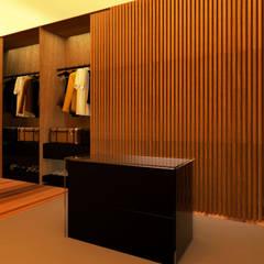 Apartamento no Lumiar: Closets  por Rita Glória interior design