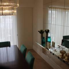 Apartamento na Avenida da Liberdade: Salas de jantar  por Rita Glória interior design