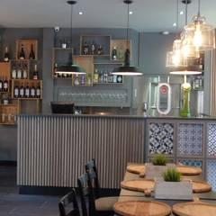 Restaurante Pizzaria- Luzzo: Espaços de restauração  por Rita Glória interior design