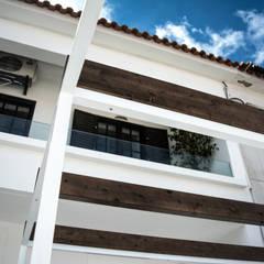 Renovação de habitação em Beja: Condomínios  por Grupo Norma