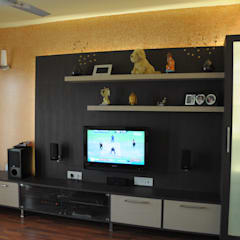 2 BHK APARTMENT INTERIORS IN BANGALORE:  Media room by BENCHMARK DESIGNS