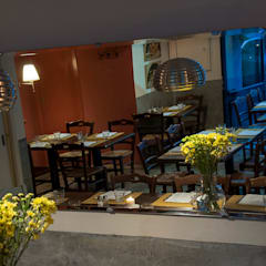 Trattoria Pennestri: Gastronomia in stile  di GVultaggio Creative Office