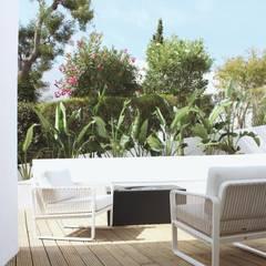 Rumah teras by ECOSSISTEMAS; Áreas Verdes e Sistemas de Rega.