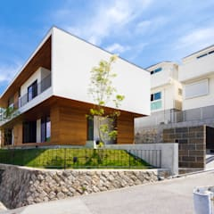 Casas de madera de estilo  por 一級建築士事務所haus