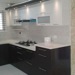 Kitchen units by URBAN HOSPEX INTERIORS