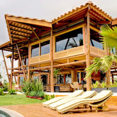 Residência Terras da Barra I: Chalés e casas de madeira  por VERRONI arquitetos associados