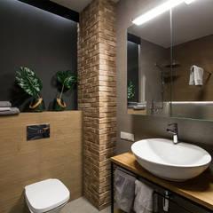 ห้องน้ำ โดย KODO projekty i realizacje wnętrz, อินดัสเตรียล