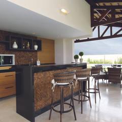 Danielle Valente Arquitetura e Interiores의  와인 보관