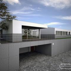moradia_garagem: Casas unifamilares  por Emprofeira - empresa de projectos da Feira, Lda.