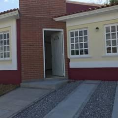casa-terracota : Casas de campo de estilo  por LUBAAL construcción y arquitectura