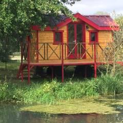 Cabane du lac: Hôtels de style  par Jardin boheme