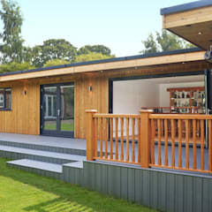 Bespoke Garden Room including study, gym, entertainment area, hot tub and BBQ area with viewing deck:  Garden by Crown Pavilions