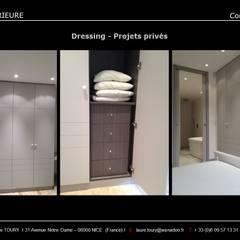 Dressing: Dressing de style de style Classique par Architecture interieure Laure Toury