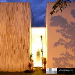 Vitor Fernando: Casas familiares  por VITOR FERNANDO Architecture