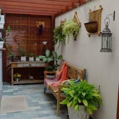 Residência Paineiras Jardins de inverno rústicos por Ambiento Arquitetura Rústico Madeira Efeito de madeira