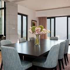 Peak Residence, Hong Kong:  Dining room by Nicole Cromwell Interior Design