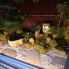 自然石を使ったモダンデザイン: 株式会社Garden TIMEが手掛けた枯山水です。