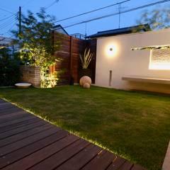 自然石を使ったモダンデザイン: 株式会社Garden TIMEが手掛けた庭です。