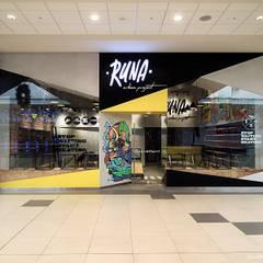 Fachada tienda RUNA: Oficinas y Tiendas de estilo  por SXL ARQUITECTOS
