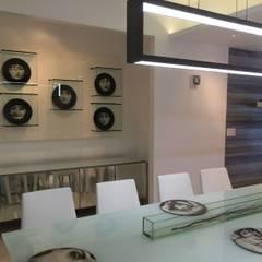 APT.13 - TORRE ANGELINI: Salas / recibidores de estilo  por Complementos C.A.