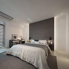 Dormitorios de estilo  por 奇承威設計事業