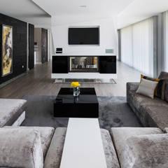 Residência J&M: Salas de estar  por UNISSIMA Home Couture,Moderno