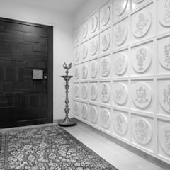 Premium home designs:  Corridor & hallway by Bric Design Group