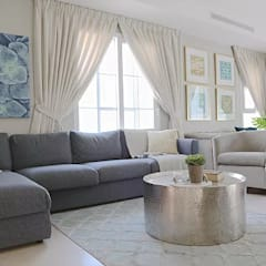 Living room by Harf Noon Design Studio