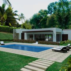 สระว่ายน้ำ by Arquitectos y Entorno S.A.S