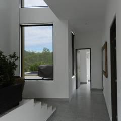 : Pasillos y vestíbulos de estilo  por Arquitectos y Entorno S.A.S