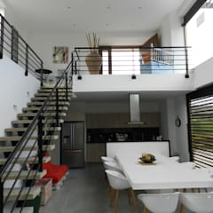 : Comedores de estilo  por Arquitectos y Entorno S.A.S