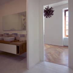 Rénovation complète d'un appartement Haussmannien : Chambre de style de style Colonial par Deco-Daix