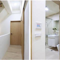 水木空間設計:  走廊 & 玄關 by 水木空間設計
