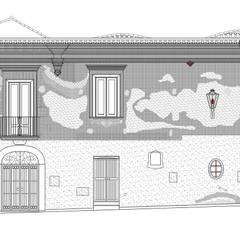 IL RESTAURO DI PALAZZO BELVEDERE: Complessi per uffici in stile  di studio arCp - architetto pasqualina casiero