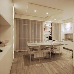 Soggiorno Moderno in una Villetta in Brianza: Sala da pranzo in stile  di JFD - Juri Favilli Design