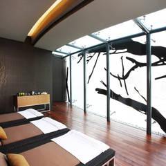 JW Marriott Santa Fe - Idea Asociados: Spa de estilo  por IDEA Asociados