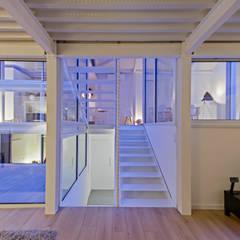 RUX: Couloir et hall d'entrée de style  par Brengues Le Pavec architectes