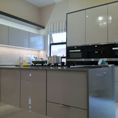 high gloss grey doors with grey counter tops and charcoal grey mat:  Built-in kitchens by Première Interior Designs