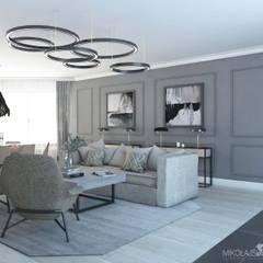 jasny salon w szarościach: styl , w kategorii Salon zaprojektowany przez MIKOŁAJSKAstudio