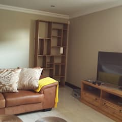 :  Media room by SOJE Interior, Design and Decor PTY (Ltd)