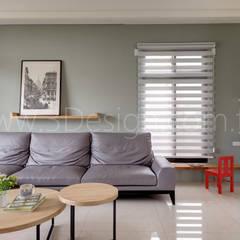 Living room by Hi+Design/Interior.Architecture. 寰邑空間設計
