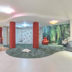 FAMAY ESPACIO RECREATIVO: Salas multimedia de estilo  de Bravo Benidorm, SL