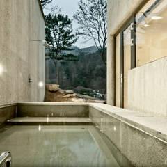 Spa de estilo moderno por 백에이어소시에이츠