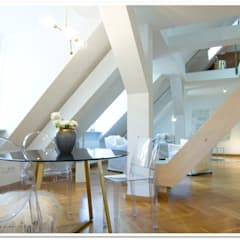 Münchner City Loft unter dem Dach mit grandioser Aussicht :  Esszimmer von Münchner home staging Agentur GESCHKA