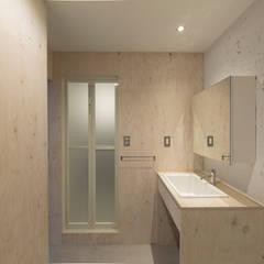 洗面室: 富永大毅建築都市計画事務所が手掛けた浴室です。