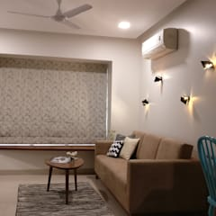 Mahim Residence got a blue touch: scandinavian Living room by Olive Roof