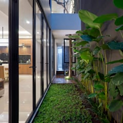'S' house: Taman zen oleh Simple Projects Architecture, Tropis